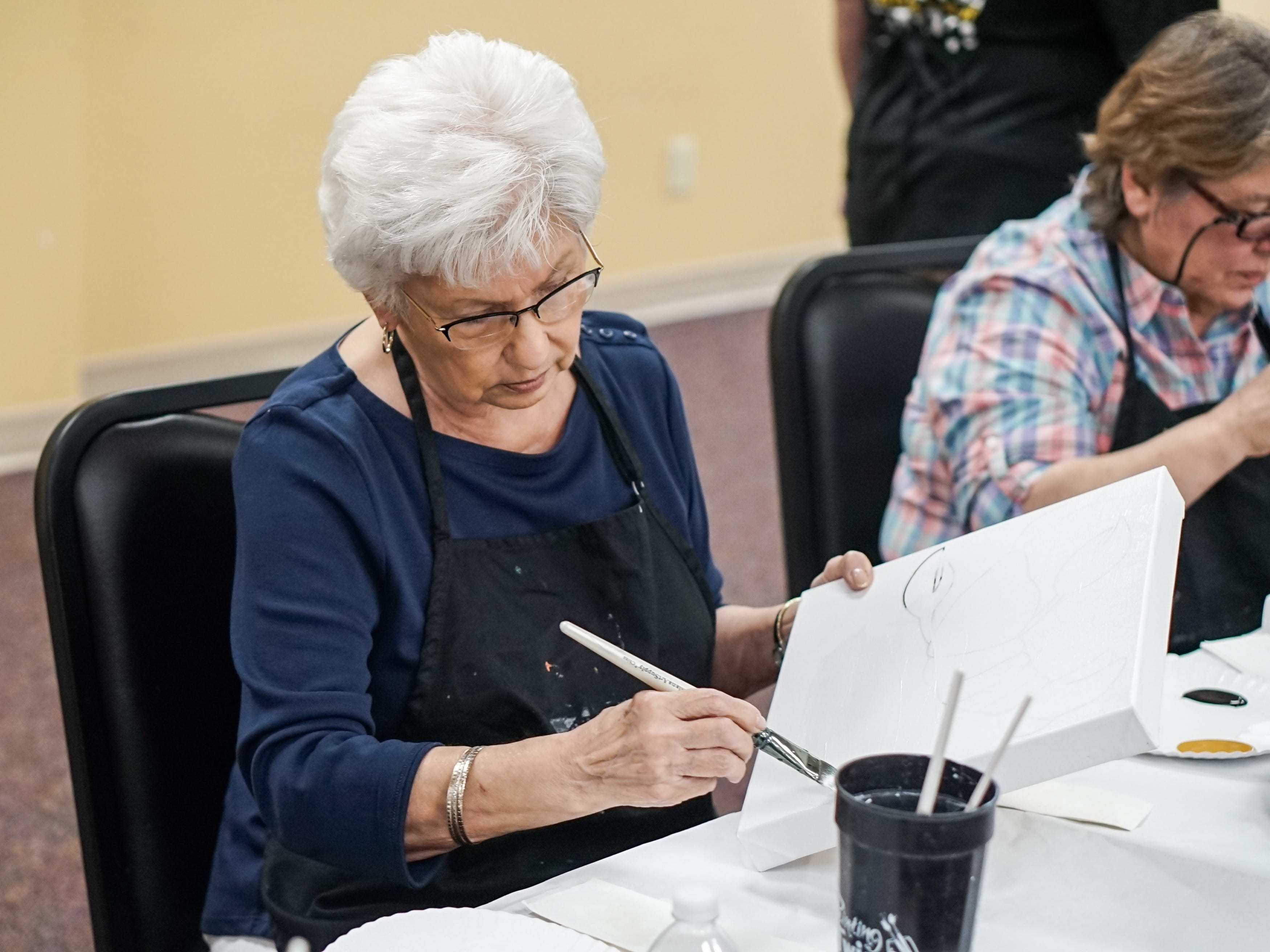 Former stroke patient Joyce Veillon enjoys painting during an event May 14 put on in conjunction with Painting with a Twist.