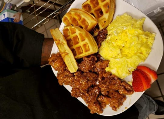 Uncle Luck's famous chicken served with waffles and scrambled eggs