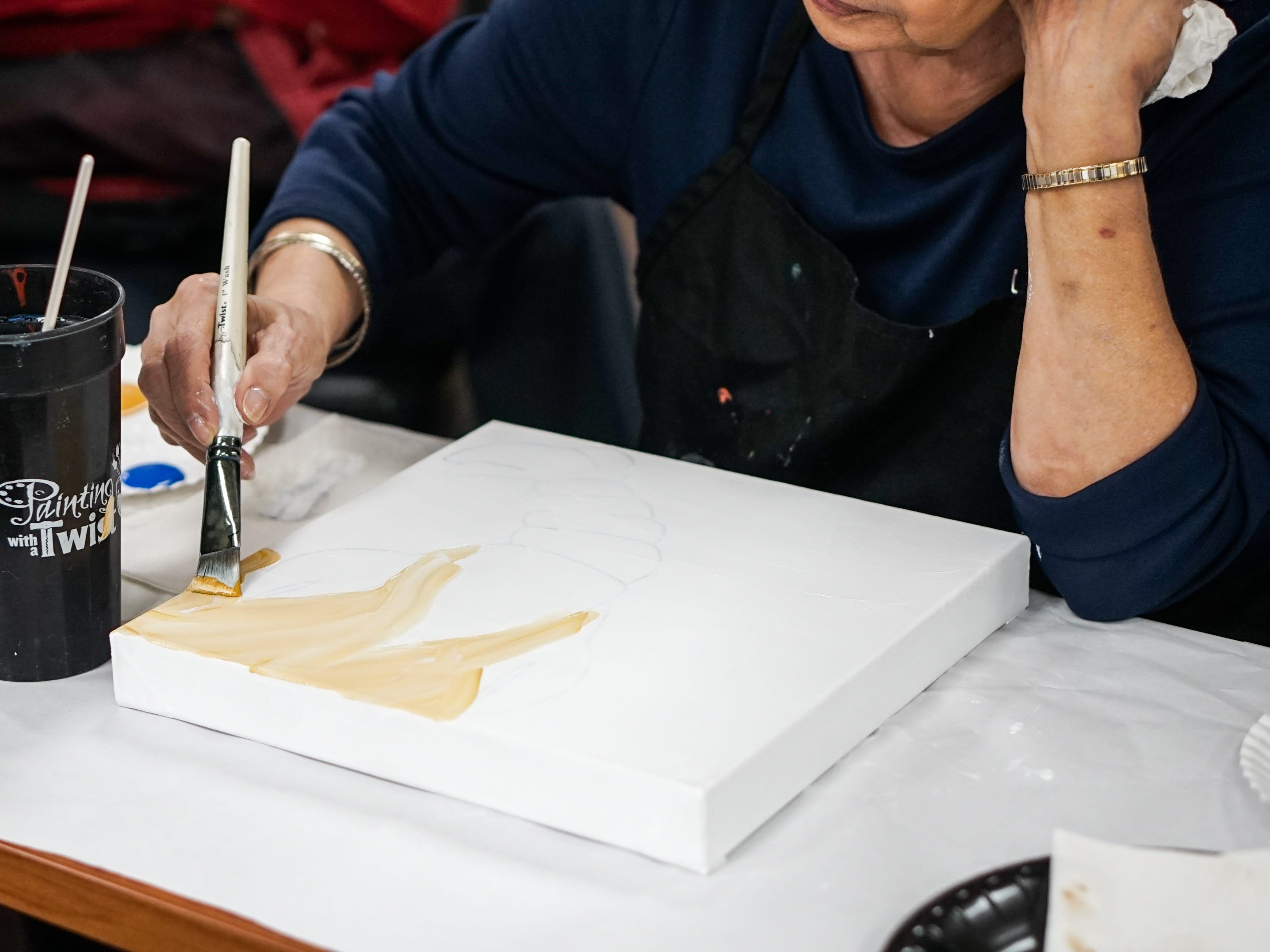 Former stroke patients who are members of Lafayette General Medical Center's Acadiana Stroke Support Group celebrate recovery with a painting event May 14 in conjunction with Painting with a Twist.