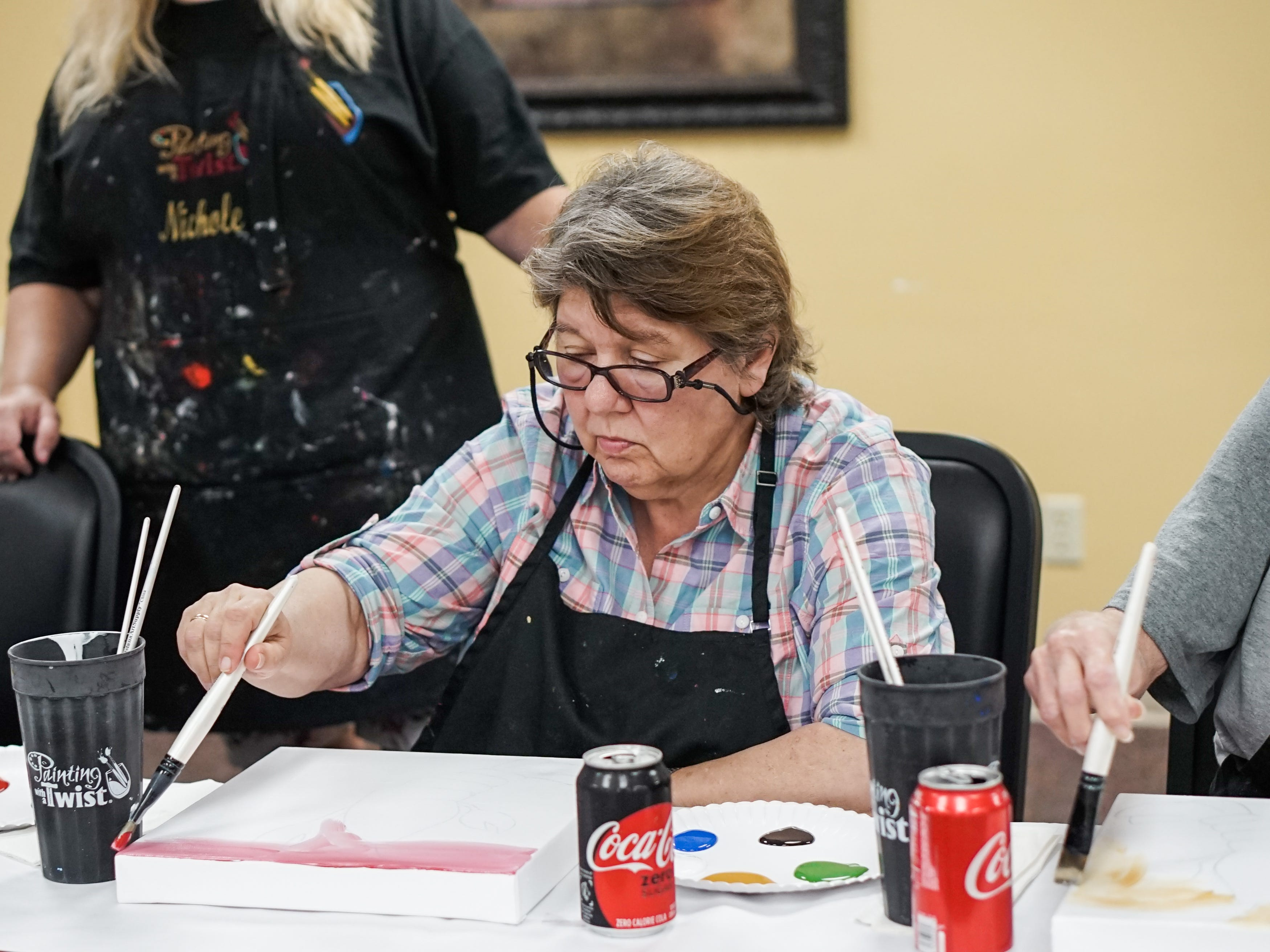 Former stroke patients who are members of Lafayette General Medical Center's Acadiana Stroke Support Group celebrated their recovery by painting a crawfish portrait in conjunction with Painting with a Twist May 14.