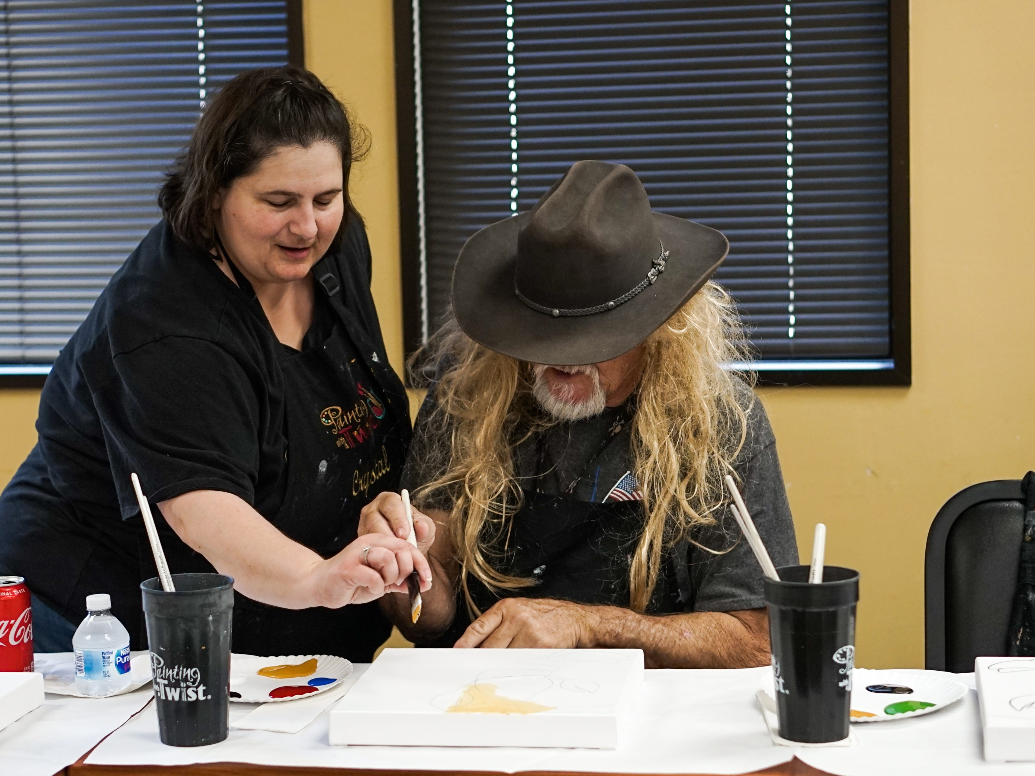 Former stroke patients who are members of Lafayette General Medical Center's Acadiana Stroke Support Group celebrate their recovery with an event May 14 in conjunction with Painting with a Twist.