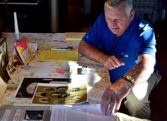 Ron Packard looks over information his discovered about his great-great grandfather Wednesday morning, May 15, 2019, at his home near Baltimore.