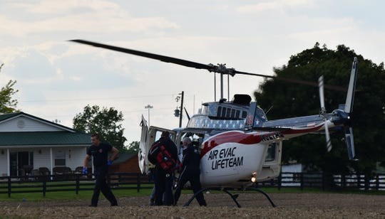 A driver in critical condition is loaded onto a medical helicopter to be transported to Grant Medical Condition, after a crash Wednesday evening on Ohio 188.