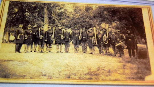 Edmund H. Dodge, seventh from left, and his brother Joseph C. Dodge, ninth from left, pose for a photograph with the rest of the Fourth Michigan Infantry Band in this photograph from 1866 in Texas.