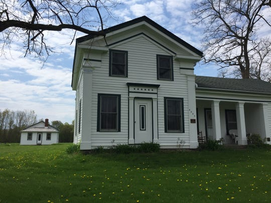 The 1855 farmhouse of Brighton area pioneer Timothy Warner and his family, seen Wednesday, May 15, 2019 with the restored 1849 Hicks School behind it, won a Governor's Award for Historic Preservation.