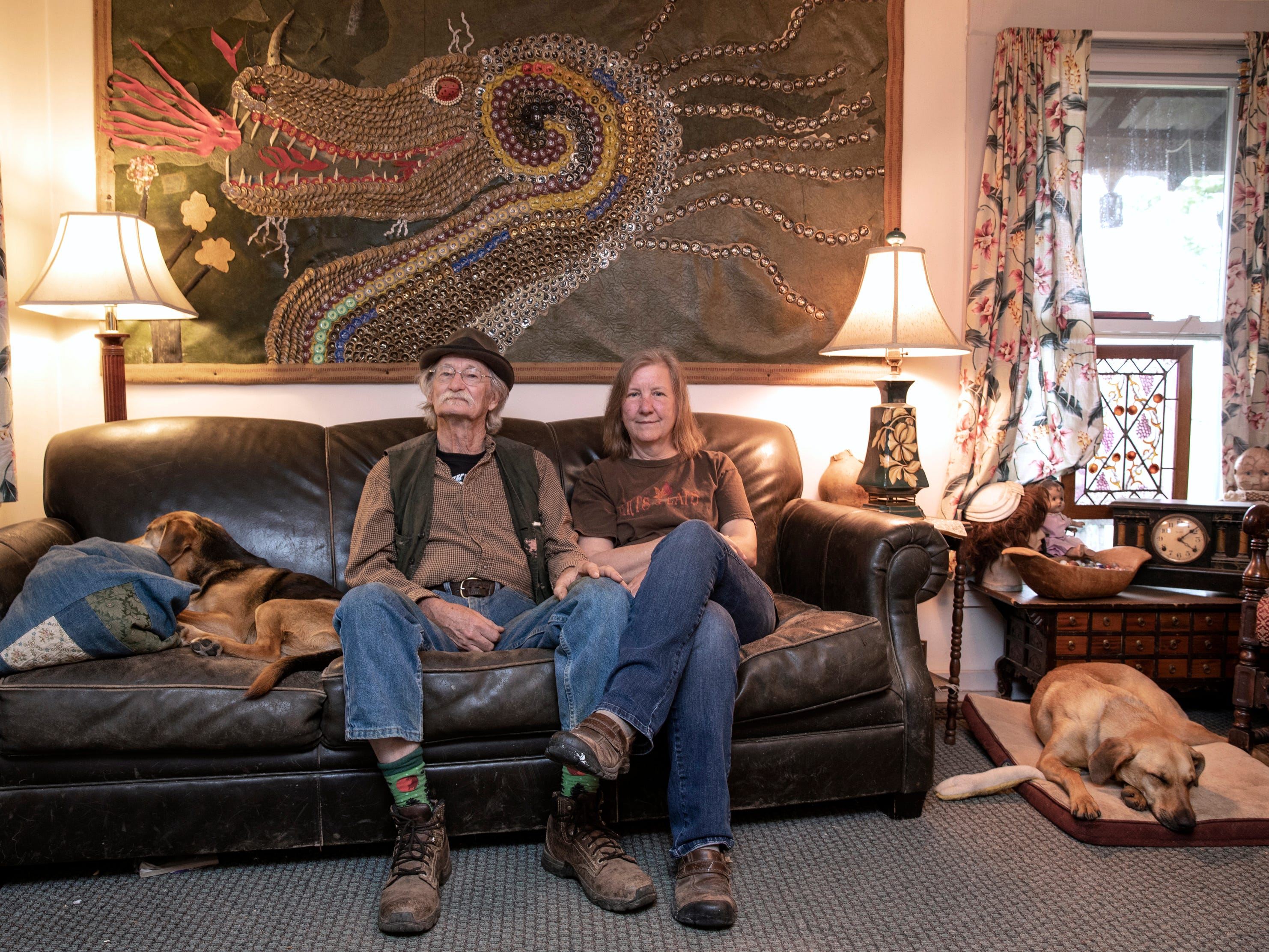 Cecil and Bet Ison sit in the living room of their home while their dogs sleep. April 19 2019.