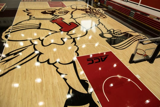 The new image of the cardinal mascot dunking has been completed on the floor of the U of L basketball practice facility on Floyd Street. May 15, 2019