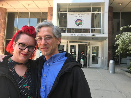 Julia Miller and Martin Mashon, the founders of Punks with Lunch Lansing, stand outside City Hall Tuesday  May 14, 2019 during a break in their trial for trespassing at the CATA bus station. A jury found them innocent Wednesday but convicted Mashon of a misdemeanor for resisting arrest.