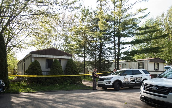 Members of the Ingham County Sheriff's Dept. work the scene of what they say is a suspicious death in Holt in the 1400 block of VanBuren Avenue. A 43-year-old woman was found dead when first responders arrived.