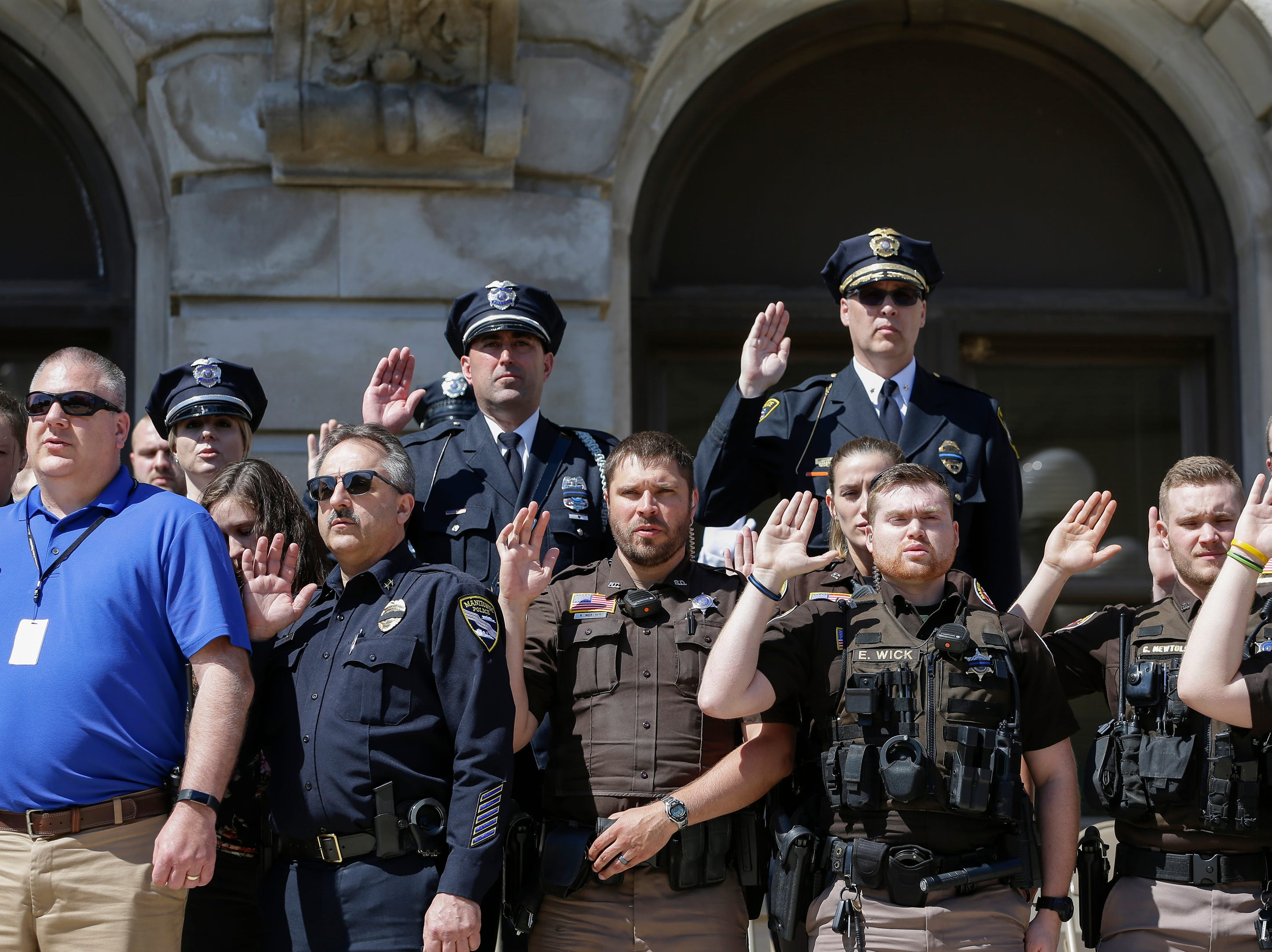 Law enforcement recites the oath of honor during the Manitowoc County Peace Officer Memorial Service Wednesday, May 15, 2019, in Manitowoc, Wis. Joshua Clark/USA TODAY NETWORK-Wisconsin