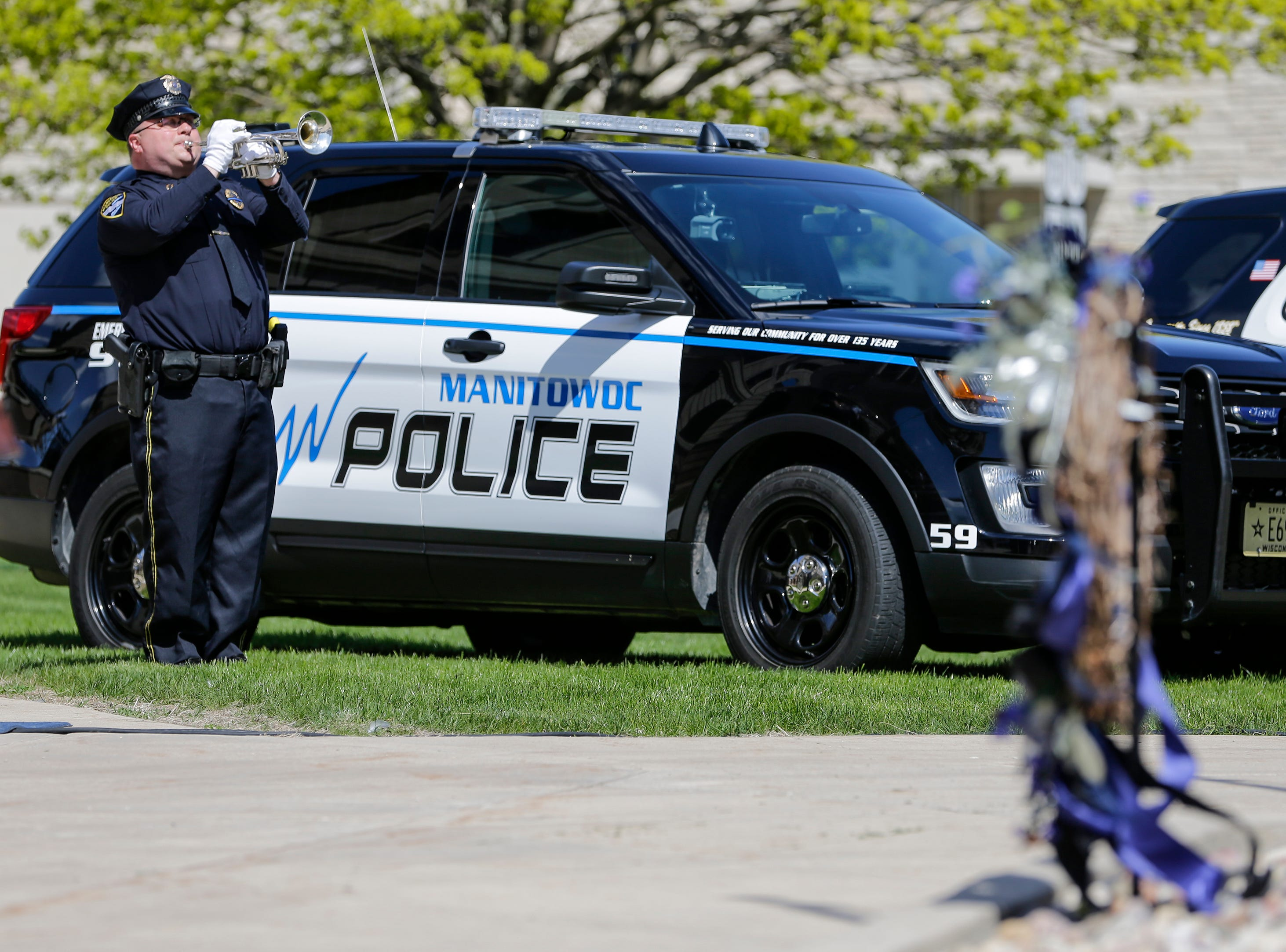 MTPD Lt. Matt Wallander plays taps in honor of the fallen heroes after the placement of the wreath during the Manitowoc County Peace Officer Memorial Service Wednesday, May 15, 2019, in Manitowoc, Wis. Joshua Clark/USA TODAY NETWORK-Wisconsin