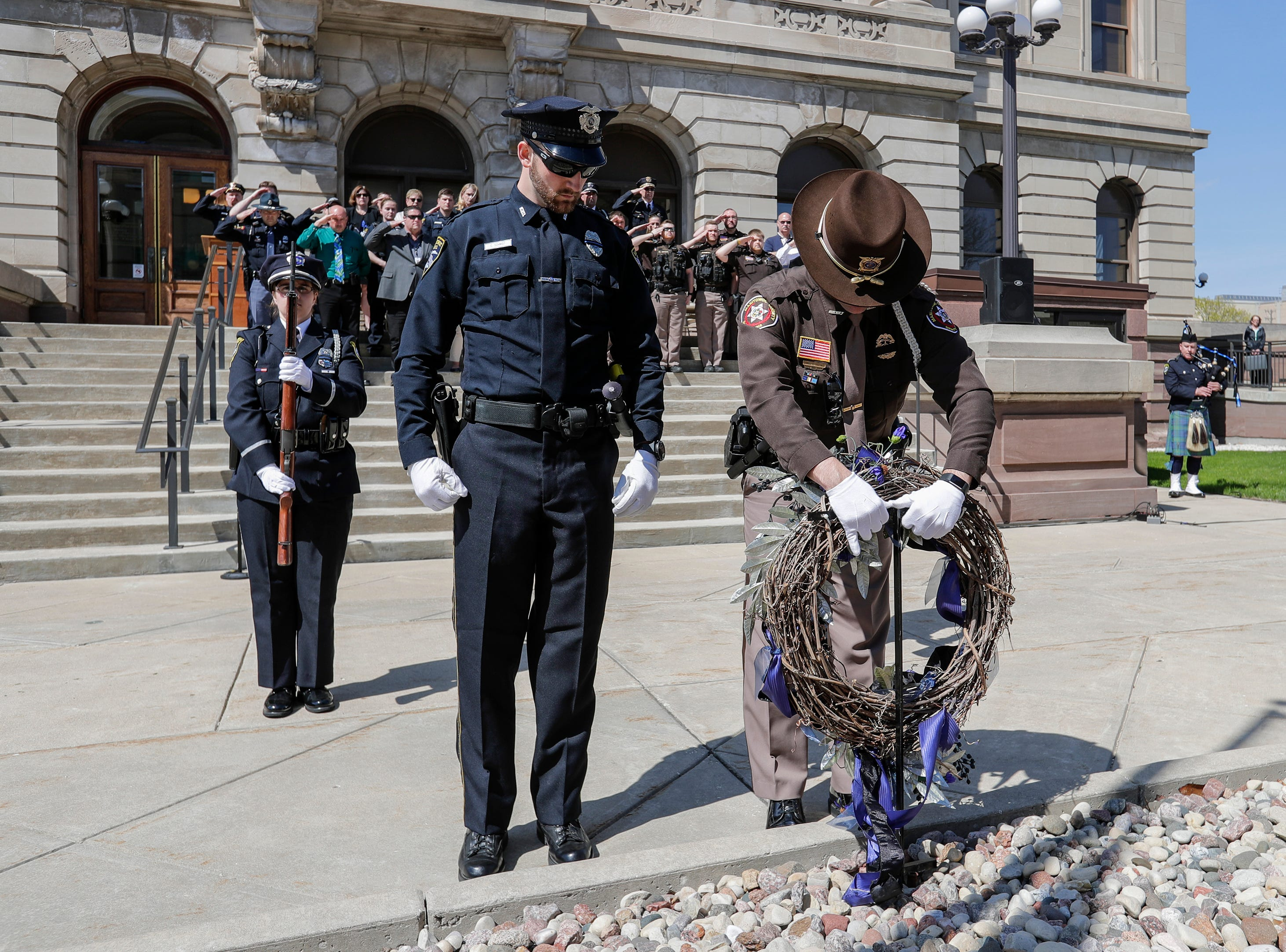 Officers place the wreath in front of the memorial during the Manitowoc County Peace Officer Memorial Service Wednesday, May 15, 2019, in Manitowoc, Wis. Joshua Clark/USA TODAY NETWORK-Wisconsin