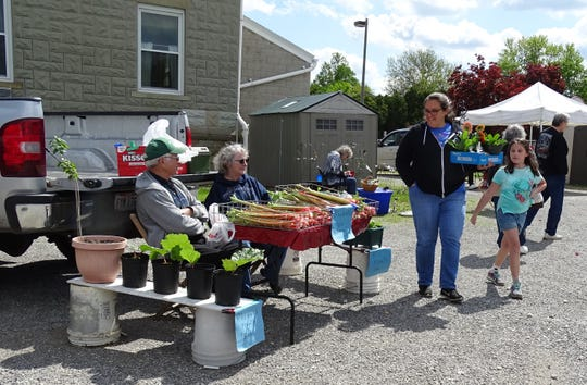 Paul and Ruth Schimpf, left, wait for customers during the Crestline Farmers' Market on Tuesday afternoon.