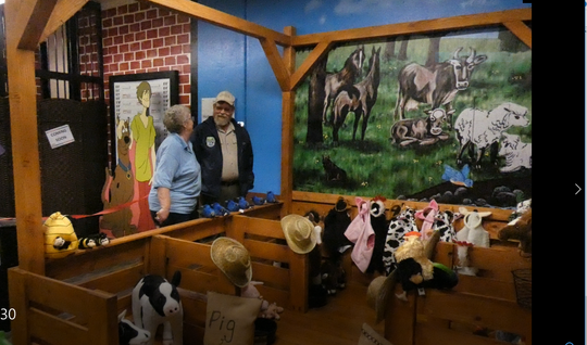 VIcki Cochran of the Malabar Farm Foundation, left, and Mark Sommer, a  naturalist at Malabar Farm State Park, talk about the new exhibit at the Little Buckeye Children's Museum on Tuesday night.