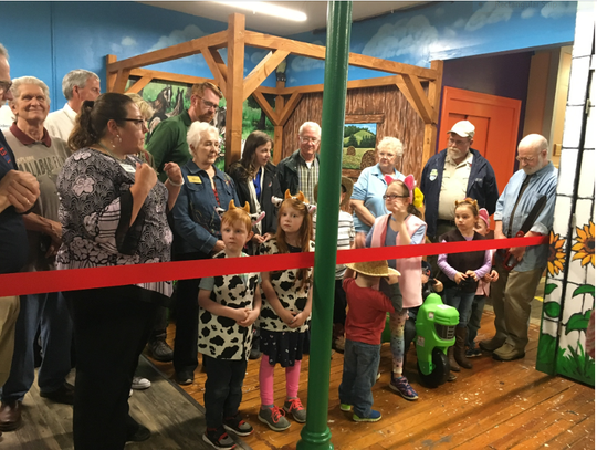 Malabar Farm is the newest exhibit at the Little Buckeye Children's Museum. Everyone celebrated a ribbon cutting Tuesday night at the West Fourth Street museum. At left, Jodie Perry of the Mansfield Area Chamber talks about the new exhibit, which includes little tractors and cow costumes for the kids.