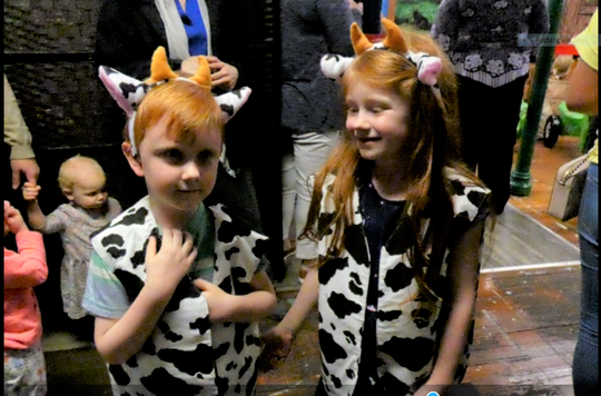 Dexter and his sister Ruby Gardner try on cow costumes at the new Malabar Farm exhibit at Little Buckeye Children's Museum.