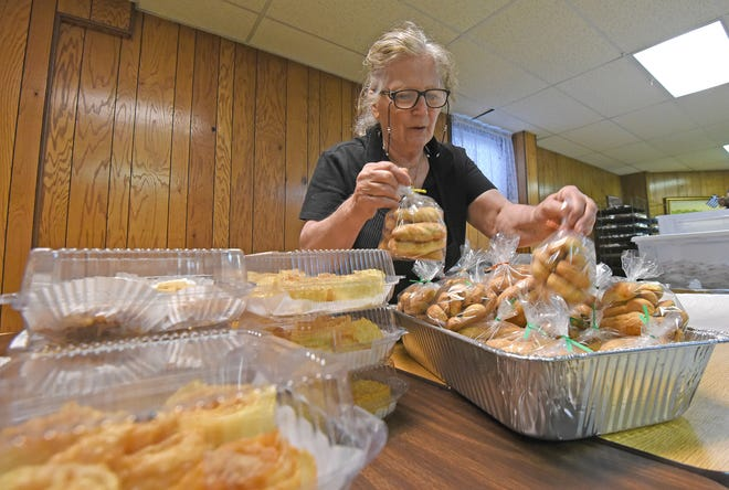 Zoe Arndt sorts through Greek desserts and baked goods Wednesday as she prepares for the Greek Festival starting on Friday, May 17, at the Sts. Constantine and Helen Greek Orthodox Church.