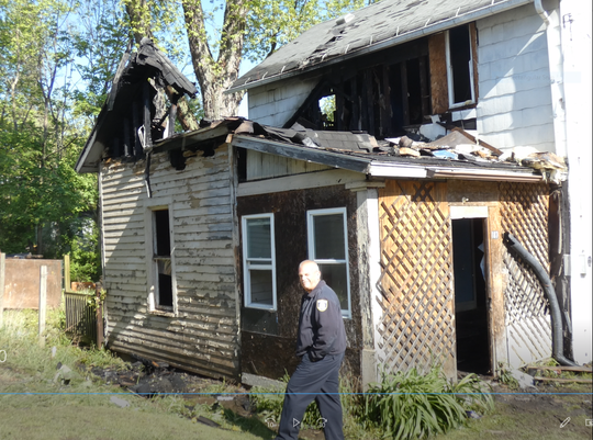 Mansfield fire Lt. Matthew Carey returned to 187 N. Benton St. Wednesday following a fire at 4:48 a.m. at the vacant house.