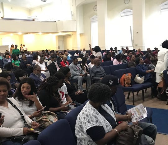 "Congregants gather in the sanctuary of Abundant Grace Fellowship Church to see comedian and actor Michael Colyar perform his one-man play, ""Momma."" The church has centered its identity around using drama as a teaching tool."