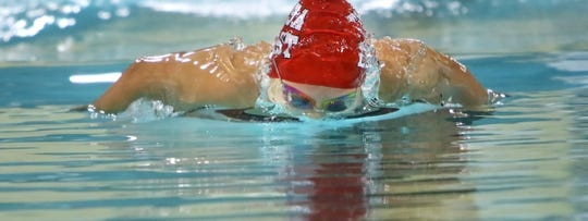 Wauwatosa East's Elizabeth Peura swims the butterfly during a 2015 meet in the Tosa East pool. Tosa East will be getting a new aquatic space thanks to a $4.7 million donation from John and Tashia Morgridge, both Wauwatosa School District alumni.