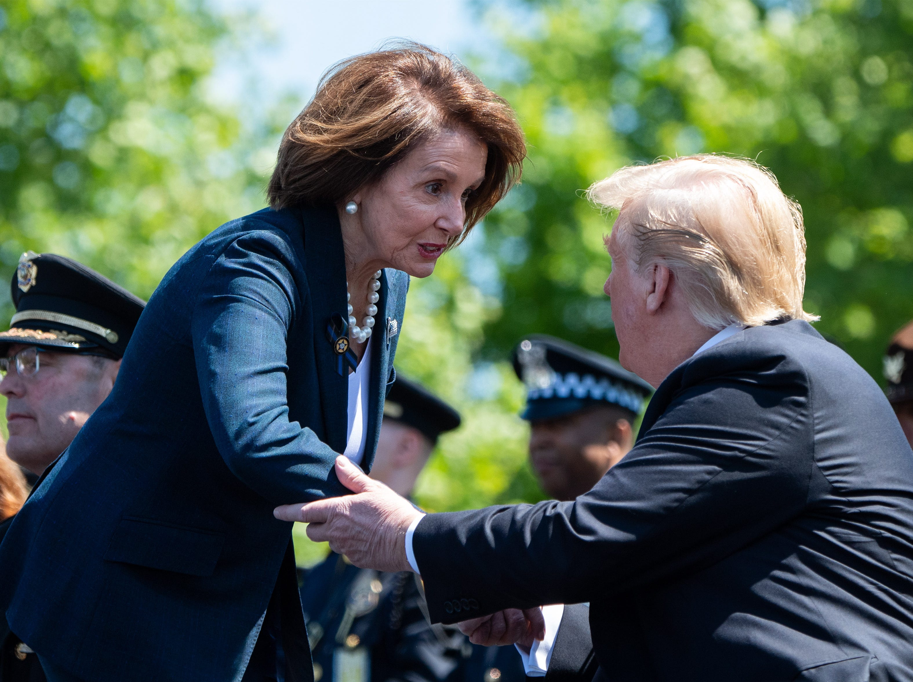President Donald J. Trump talks to Speaker of the House Nancy Pelosi, D-Calif., during the 38th annual National Peace Officers' Memorial Service