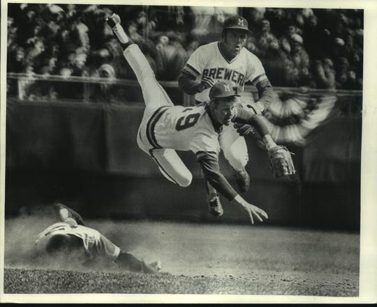 Robin Yount GOES airborne for a double play. Robin Yount, the 18 year old rookie who started at shortstop in the Milwaukee Brewers' opener Friday, learned early what life is like in the major leagues.