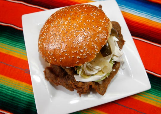 The cemita poblana from El Tlaxcalteca, 1300 W. Burnham St., covers an entire plate. And it's not a tiny plate. The bun typically holds a breaded cutlet of steak or chicken plus cheese and avocado.