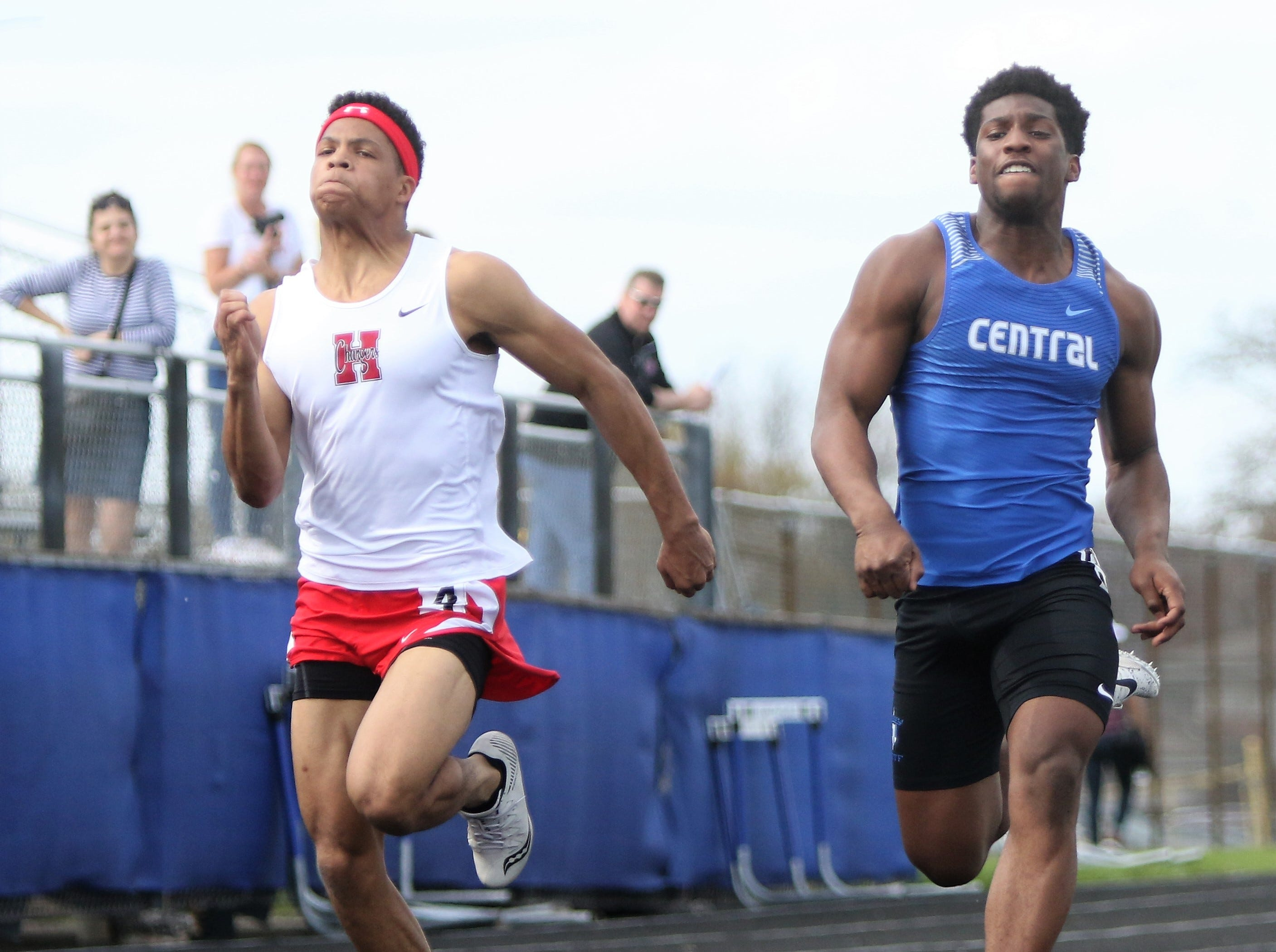 Sussex Hamilton's Josh Reindl (left) edges out Brookfield Central's Rashad Lampkin in a 100 dash heat at the Greater Metro Conference outdoor championships on May 14, 2019.
