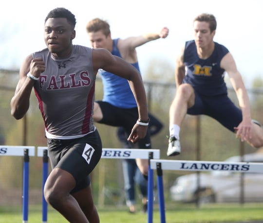 Tamir Thomas of Menomonee Falls wins the 300 hurdles at the Greater Metro Conference outdoor championships on May 14, 2019.