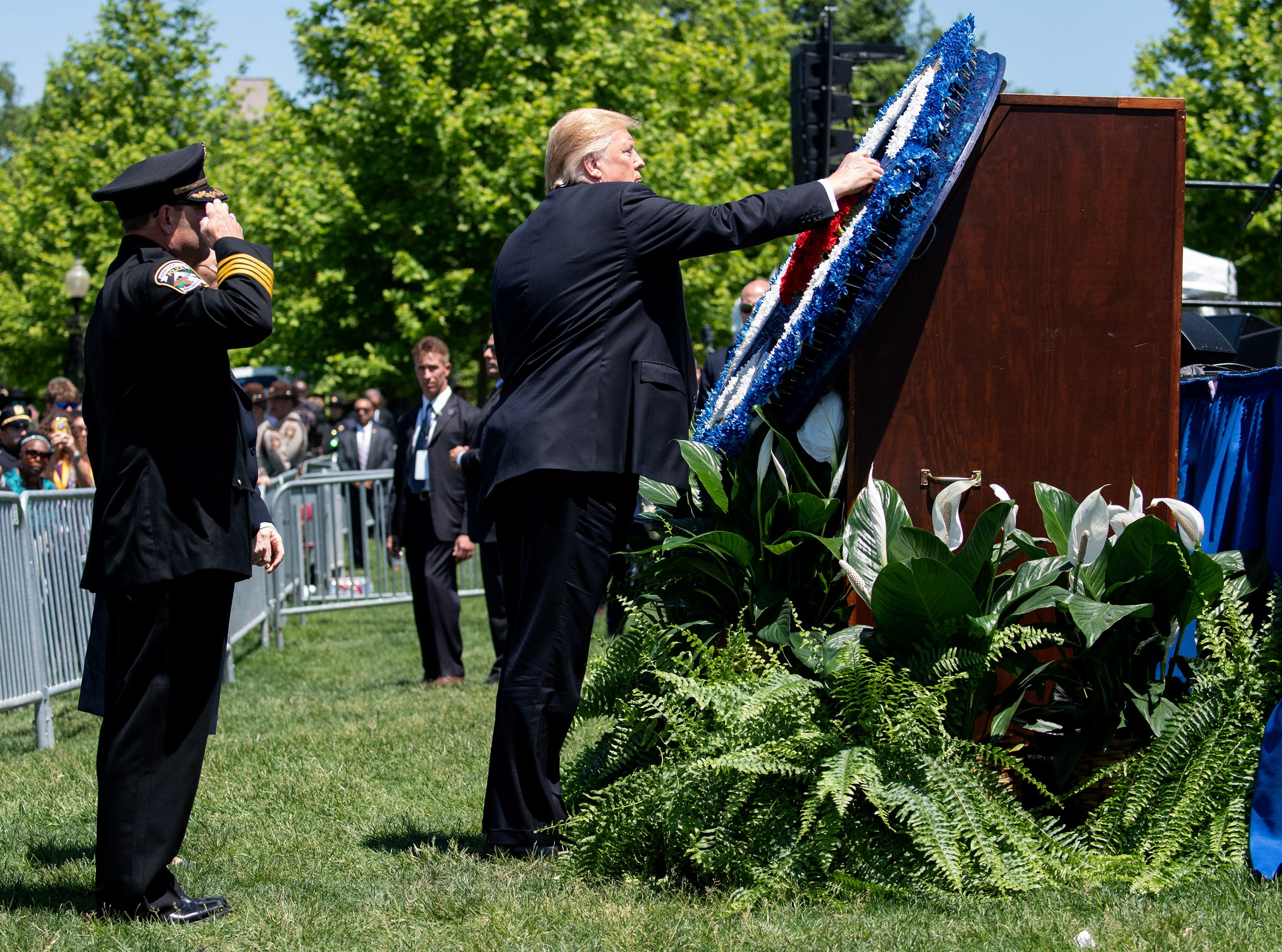President Donald J. Trump places a flower on a wreathes during the 38th annual National Peace Officers' Memorial Service.