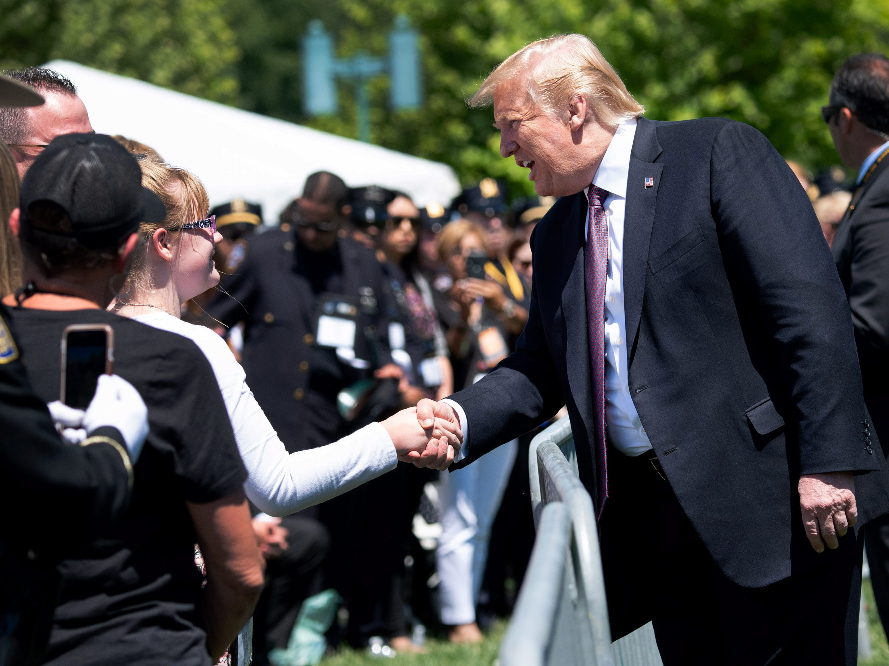 President Donald J. Trump greets audience members during the 38th annual National Peace Officers' Memorial Service.