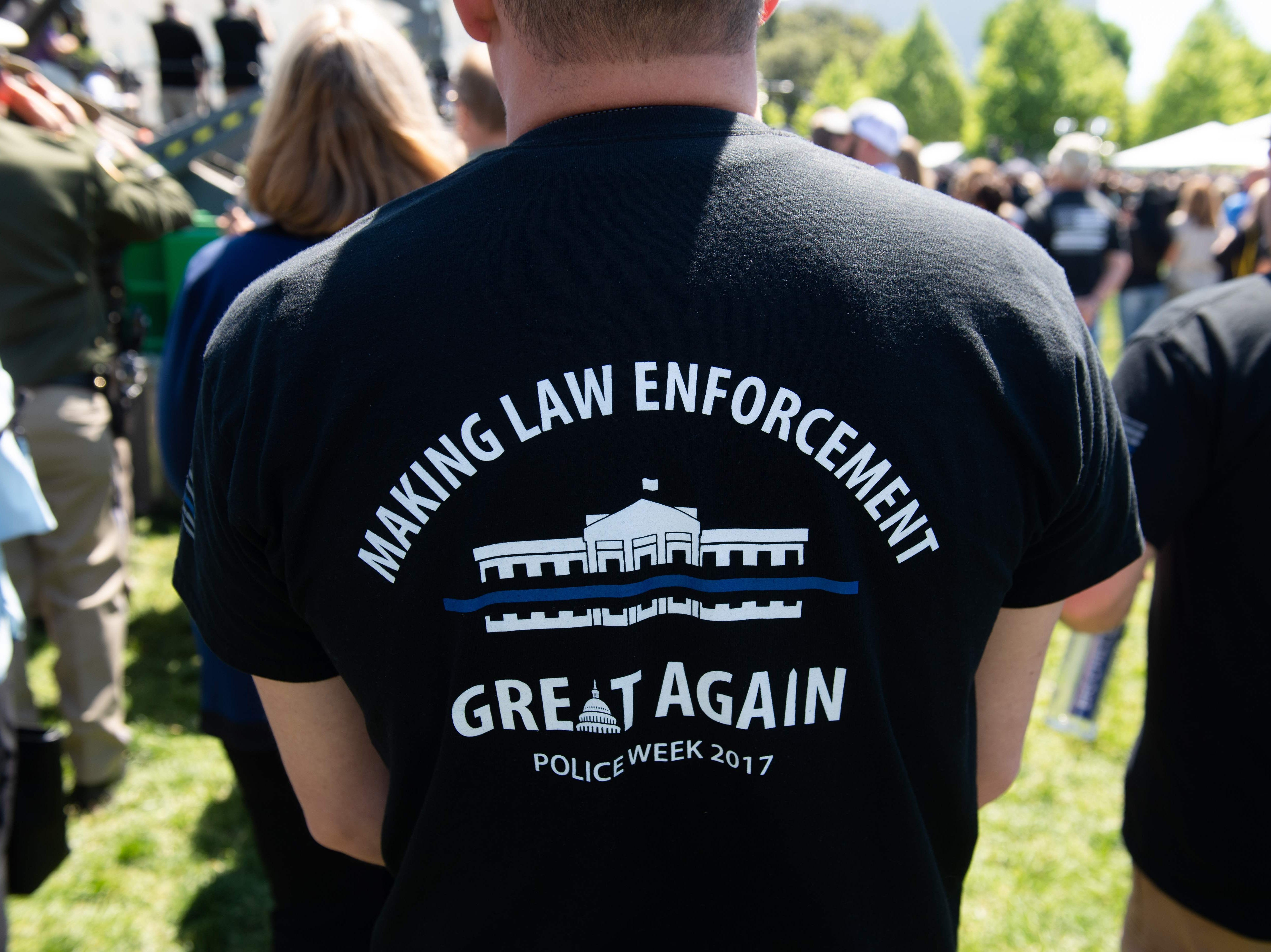 Members of police departments around the country look on during the 38th Annual National Peace Officers Memorial Service.
