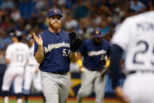 Milwaukee Brewers starting pitcher Brandon Woodruff (53) reacts as he walks back to the dugout as he left bases loaded during the first inning against the Tampa Bay Rays at Tropicana Field.