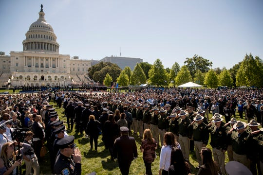 Families of fallen police officers arrive at the 38th Annual National Peace Officers Memorial Service on the West Lawn of the Capitol Building in Washington.