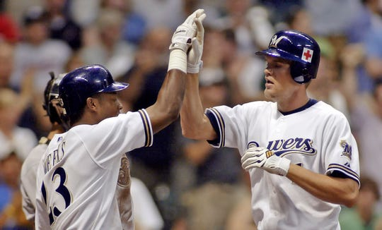 Milwaukee Brewers' Corey Hart, right, is congratulated by Rickie Weeks, left, after hitting a pinch-hit, two-run home run against the Houston Astros in the third inning of Saturday, Sept. 10, 2005, game Milwaukee.