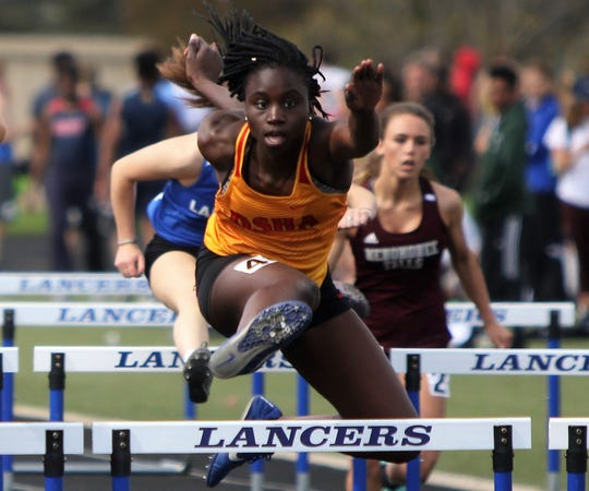 Laetitia Faye of DSHA wins her preliminary heat of the 100 meter hurdles at the Greater Metro Conference outdoor championships on May 14, 2019.