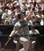 Milwaukee Brewers GeOff Jenkins watches as his three-run homer sails over the right field wall during the first inning against the Colorado Rockies at Coors Field in Denver Saturday, May 16, 1998.