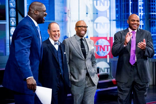 Ernie Johnson (second from left) shares a laugh with other members of his Inside the NBA team on TNT: (from left), Shaquille O'Neal, Kenny Smith and Charles Barkley.