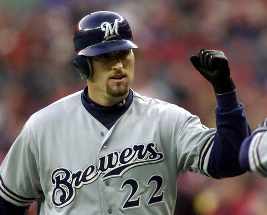Milwaukee Brewers' Kevin Barker is congratulated after hitting a solo home run in the third inning against the Cincinnati Reds, Wednesday, April 5, 2000, in Cincinnati.