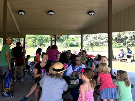 Kids and seniors who participated in the North Shore Library's pen pal program were able to meet in-person during a picnic in Ellsworth Park last summer.