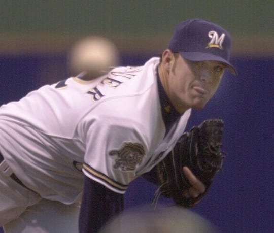 Brewer pitcher Nick Neugebauer fires home in 2002.