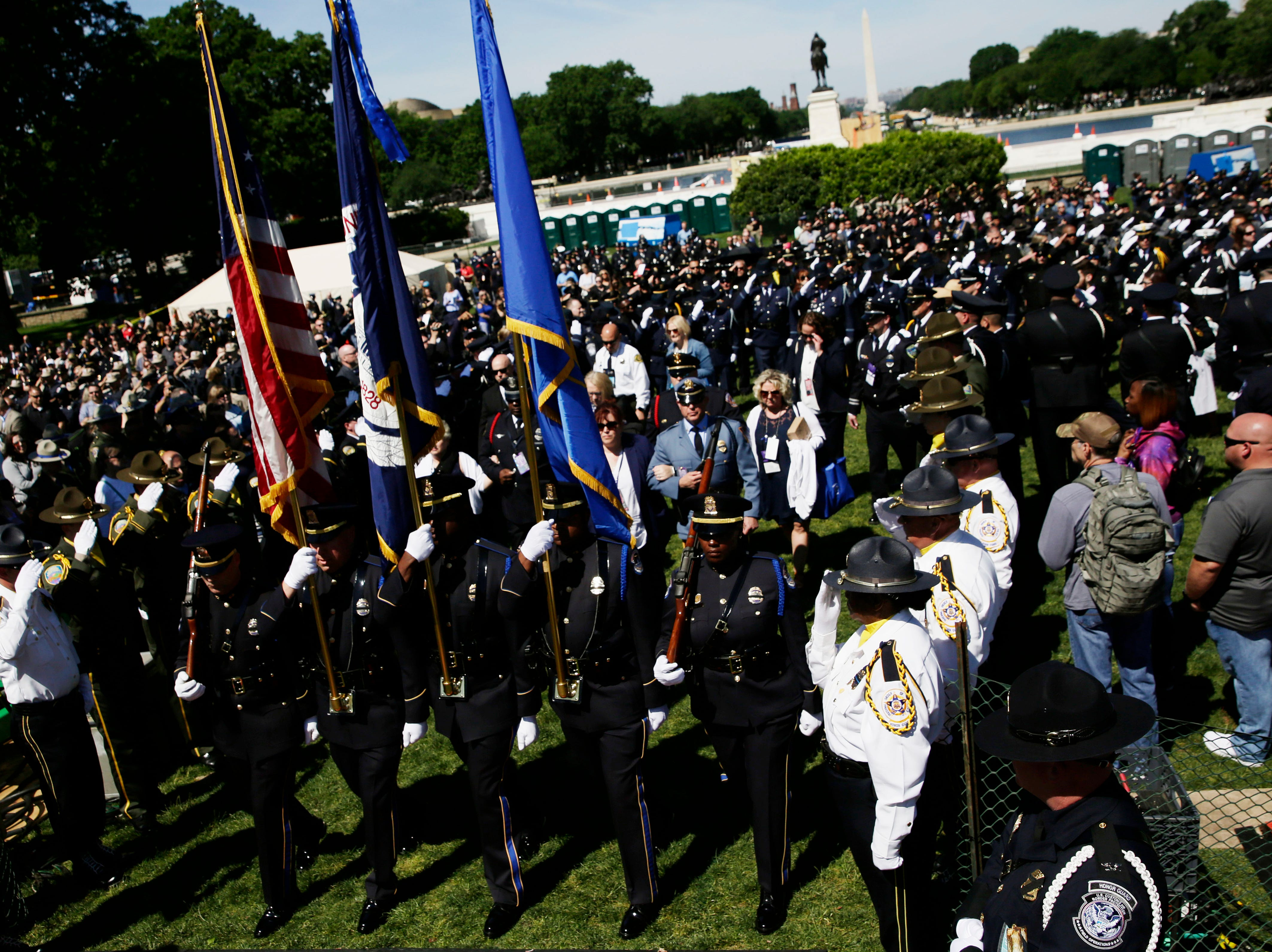 Led by color guards, family members of fallen officers arrive at the 38th Annual National Peace Officers Memorial Service at the west front of the Capitol in Washington, D.C.