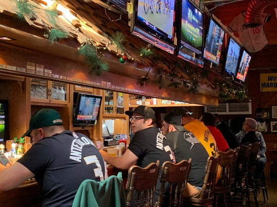 Bucks fans line the bar Major Goolsby's before Wednesday's game.