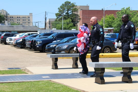 The MPD honor guard and Chief Eugene Ellis lay the wreath at a ceremony held in Monroe on Wednesday to commemorate National Police Week.