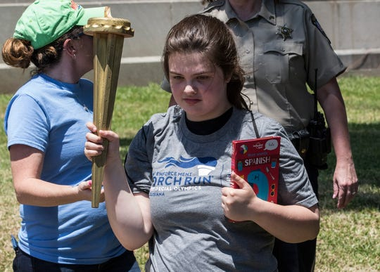 """Several law enforcement agencies helped to carry the """"Flame of Hope"""" torch into Monroe, La. to meet with Special Olympic athletes during Ouachita Parish's leg of the Law Enforcement Torch Run on May 15. The run is used to raise awareness for the upcoming Special Olympics of Louisiana State Summer Games taking place in Hammond on May 24."""