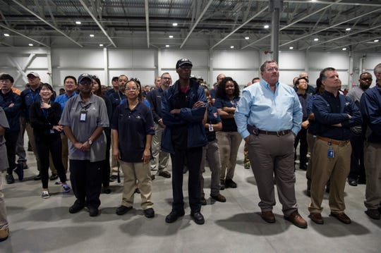 Employees watch during the new engine plant grand opening at the Hyundai plant in Montgomery, Ala., on Wednesday, May 15, 2019.