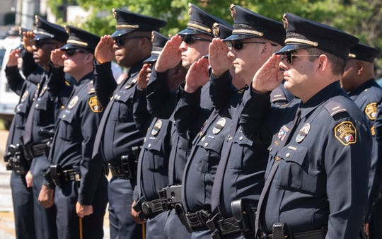 Montgomery Police officers salute during the 2019 Police Memorial Day Service at the Montgomery Police Department in Montgomery, Ala., on Wednesday May 15, 2019.