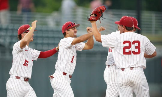 Alabama graduate relief pitcher Jeremy Randolph (23) celebrates with freshmen infielders Daniel Carinci (1) and Isaiah Byars after closing out a 2-1 win over No. 18 Texas A&M last Saturday, May 11, 2019 from Sewell-Thomas Stadium in Tuscaloosa, Alabama. (Photo by Kristen Taylor/Alabama athletics)