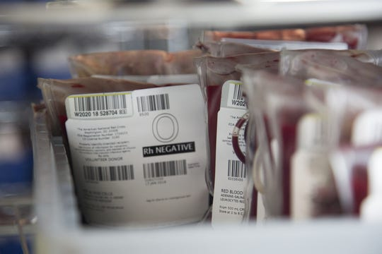 O-negative red blood cells wait in the refrigerator for distribution to a hospital.