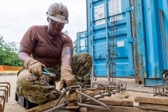 Steelworker 3rd Class Melessa Smoke, from Millbrook ties together rebar cages during the construction of the new Nan U Medical Dispensary in Pohnpei, Federated States of Micronesia on May 7.